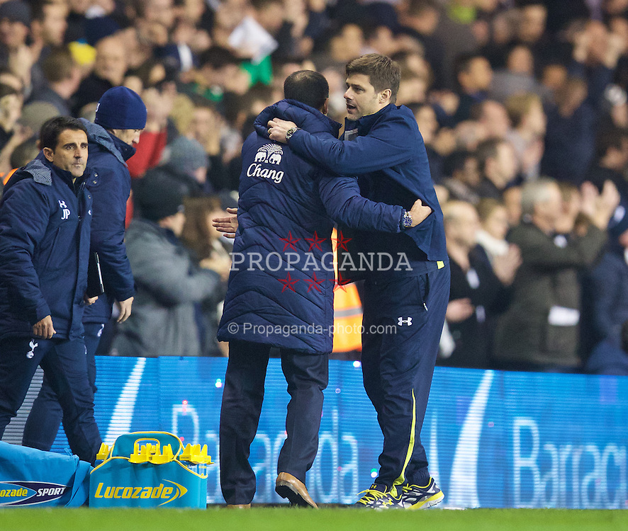 LONDON, ENGLAND - Sunday, November 30, 2014: Tottenham Hotspur's manager Mauricio Pochettino shakes hands with Everton's manager Roberto Martinez after the Premier League match at White Hart Lane. (Pic by David Rawcliffe/Propaganda)