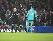 Chelsea goalkeeper Thibaut Courtois yellow card during the Barclays Premier League match between Chelsea and West Bromwich Albion at Stamford Bridge, London, England on 13 January 2016. Photo by Matthew Redman.