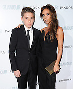 04.JUNE.2013. LONDON<br /> <br /> VICTORIA AND BROOKLYN BECKHAM ATTEND THE 2013 GLAMOUR AWARDS IN BERKLEY SQUARE.<br /> <br /> BYLINE: EDBIMAGEARCHIVE.CO.UK<br /> <br /> *THIS IMAGE IS STRICTLY FOR UK NEWSPAPERS AND MAGAZINES ONLY*<br /> *FOR WORLD WIDE SALES AND WEB USE PLEASE CONTACT EDBIMAGEARCHIVE - 0208 954 5968*