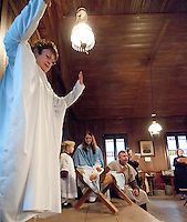 """Angels Donna Lee Fowlie and seven year old Olivia Sevin along with """"Mary"""" Katie Parrish and """"Joseph"""" Bob Landry present The Living Nativity at the Thompson-Ames Historical Society Sunday afternoon.  (Karen Bobotas/for the Laconia Daily Sun)"""