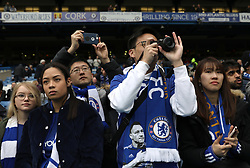 Chelsea fans in the stands during the Premier League match at Stamford Bridge, London.