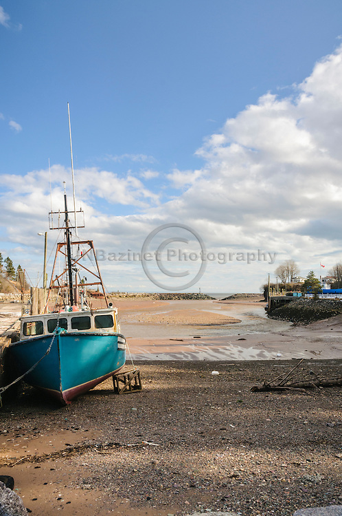 Fishing boat at low tide in St. Martins New Brunswick, Canada