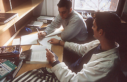 University students studying in library,