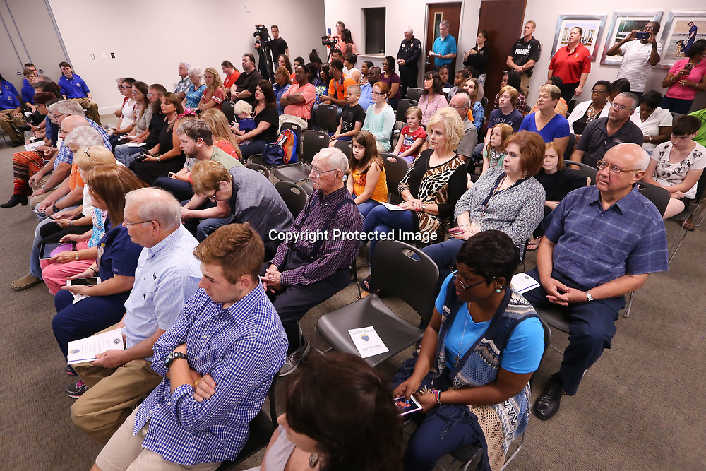 Family members gather in the community room at the Tupelo Police Department for the Junior Police Academy graduation ceremony Friday morning.