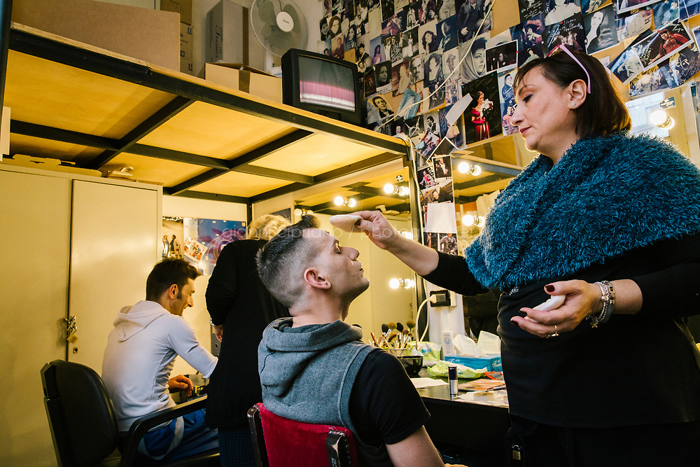 PALERMO, ITALY - 18 FEBRUARY 2018: Dancer Marcello Carini (center), who interprets the role of Gamache in &quot;Don Quixote&quot;, has his make-up done by make-up artist Maria Lucia Lucchese shortly before the dress rehearsal at the Teatro Massimo in Palermo, Italy, on February 18th 2018.<br /> <br /> The Teatro Massimo Vittorio Emanuele is an opera house and opera company located  in Palermo, Sicily. It was dedicated to King Victor Emanuel II. It is the biggest in Italy, and one of the largest of Europe (the third after the Op&eacute;ra National de Paris and the K. K. Hof-Opernhaus in Vienna), renowned for its perfect acoustics. It was inaugurated in 1897.