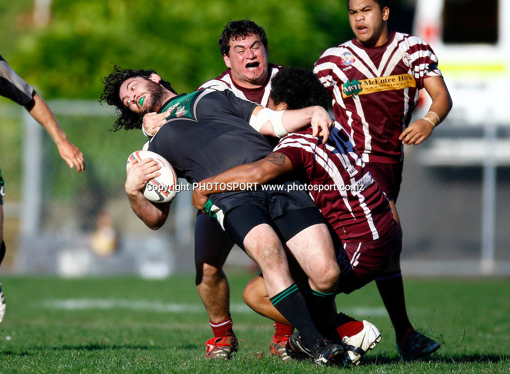 Bays Tane Hart is tackled hard, Auckland Rugby League, Fox Memorial Trophy semi-final, East Coast Bays v Papakura, Mt Smart no 2 field, Auckland. 22 August 2009. Photo: William Booth/PHOTOSPORT