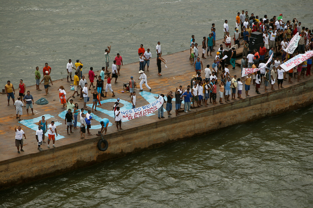 Loggers demonstrate against Greenpeace on a barge in the Jaurucu River at Porto de Moz in in Brazil. The Greenpeace ship M.V. Arctic Sunrise was later boarded by the demonstrators.