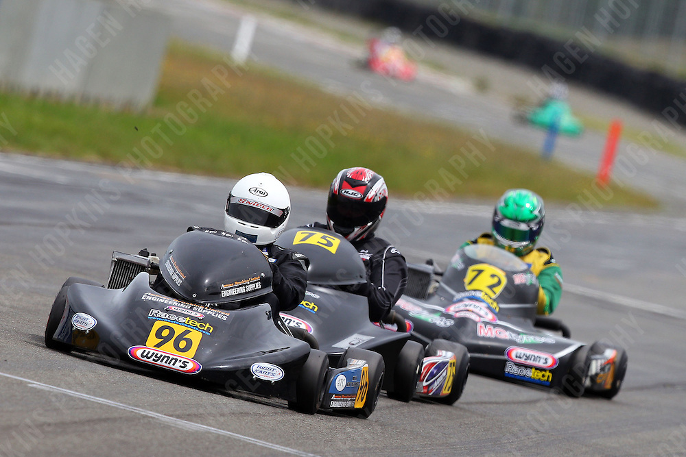 Teddy Bassick, 96, Daniel Sayles, 75, and Aarron Cunningham, 72, race in the Rotax Heavy class during the 2012 Superkart National Champs and Grand Prix at Manfeild in Feilding, New Zealand on Saturday, 7 January 2011. Credit: Hagen Hopkins.