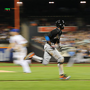 Dee Gordon, Miami Marlins, running home from a sacrifce fly by Justin Bour during the New York Mets Vs Miami Marlins MLB regular season baseball game at Citi Field, Queens, New York. USA. 16th September 2015. Photo Tim Clayton