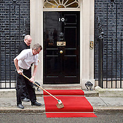 His Majesty King Abdullah II of Jordan to Downing Street. 10 Downing Street, London, Great Britain <br /> 1st March 2017 <br /> <br /> No 10 workmen lay out and brush the red carpet ahead of the visit by <br /> King Abdullah II of Jordan <br /> <br /> <br /> Photograph by Elliott Franks <br /> Image licensed to Elliott Franks Photography Services