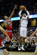 Apr 27, 2010; Cleveland, OH, USA; Cleveland Cavaliers guard Mo Williams (2) shoots over Chicago Bulls guard Derrick Rose (1) during the first period in game five in the first round of the 2010 NBA playoffs at Quicken Loans Arena.  Mandatory Credit: Jason Miller-US PRESSWIRE
