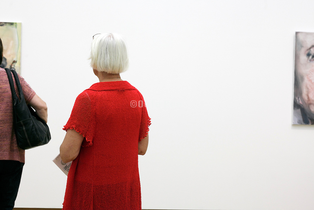Netherlands, Amsterdam, Visitor at the show of the work of artist Marlene Dumas.