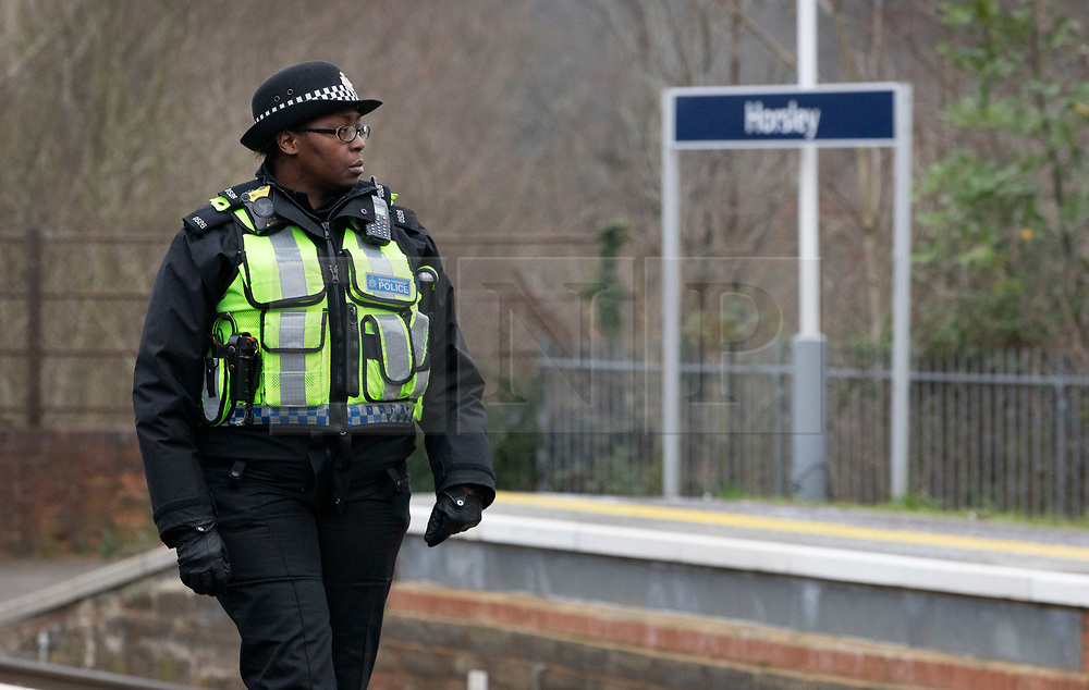 © Licensed to London News Pictures. 05/01/2019. Horsley, UK. A British Transport police officer patrols at Horsley station in Surrey where a man was stabbed to death on a train yesterday. A murder investigation has been launched after the man was attacked while on board the 12. 58pm train service travelling between Guildford and London Waterloo. A man and a woman have been detained by police in Farnham in connection with the murder. Photo credit: Peter Macdiarmid/LNP