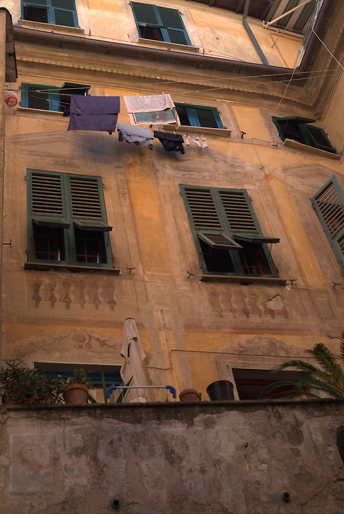 Laundry hanging outside windows in Lucca, Italy