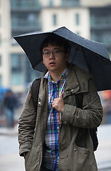 © Licensed to London News Pictures. 14/05/2015. Bristol, UK. A man with an umbrella braving the wet weather in Bristol city centre today, Thursday 14th May 2015. Photo credit : Rob Arnold/LNP