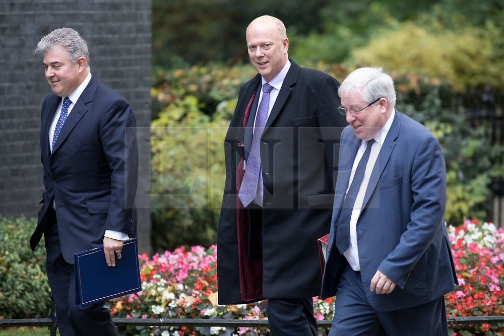 © Licensed to London News Pictures. 17/10/2017. London, UK. Minister of State for Immigration Brandon Lewis, Transport Secretary Chris Grayling and Chancellor of the Duchy of Lancaster Patrick McLoughlin arriving in Downing Street to attend a Cabinet meeting this morning. Photo credit : Tom Nicholson/LNP