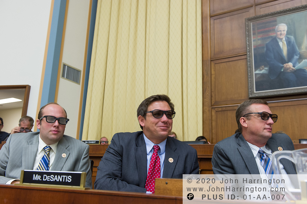 """Rep. Jason Smith (R-MO) (left), Rep. Ron DeSantis (R-FL) (center), and Rep. Doug Collins (R-GA) (right) don 3D glasses to view a demonstration of 3D technology during testimony to the U.S. House of Representatives Committee on the Judiciary, Subcommittee on Courts, Intellectual Property and the Internet on the subject """"Innovation in America: The Role of Copyrights"""", Thursday July 25, 2013 on Capitol Hill in Washington DC."""