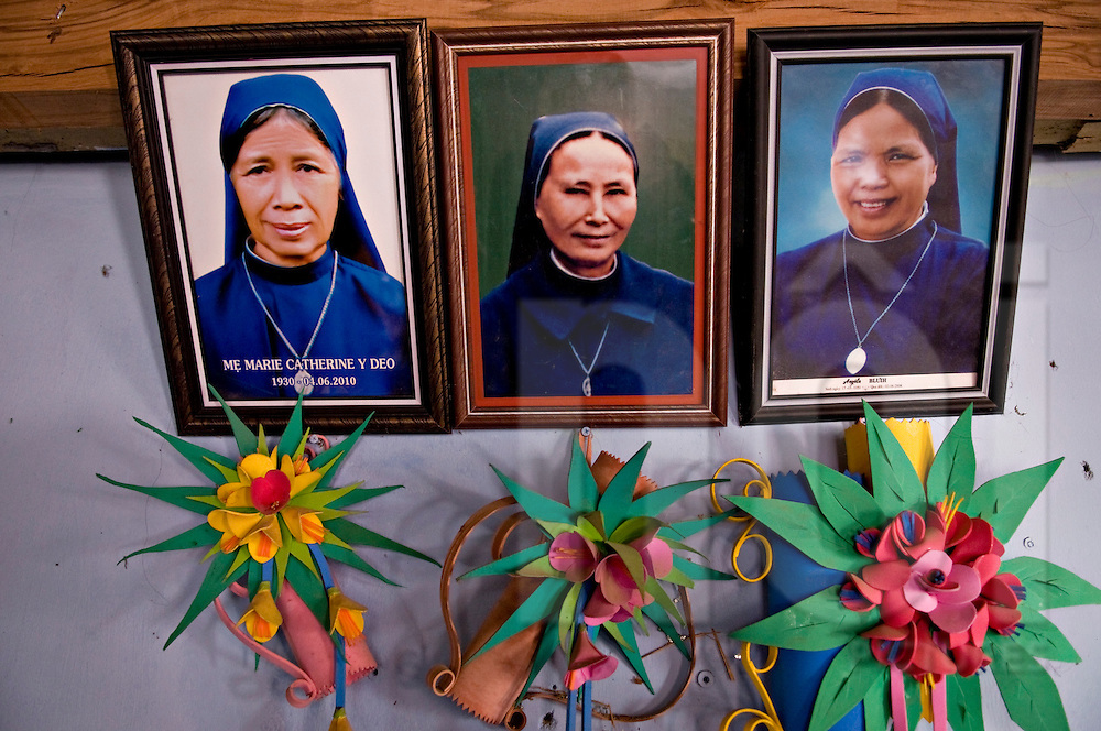 Picture portraits of vietnamese catholic nuns sticked to the wall in Kontum's church, Vietnam, Asia