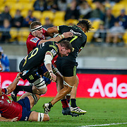 Ardie Savea breaks through tackles during the Super rugby union game (Round 14) played between Hurricanes v Reds, on 18 May 2018, at Westpac Stadium, Wellington, New  Zealand.    Hurricanes won 38-34.