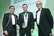 From Left, Larry Starr, Travis Kidner and Ron Teplitzky pose after Kidner was awarded the Charles J and Claire O. Ping Recent Graduate Award during the 2016 Alumni Awards Gala at Ohio University's Baker Center Ballroom on Friday, October 07, 2016.