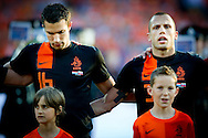 During the national anthems Robin van Persie (l) and John Heitinga The Netherlands versus    Slovakia during friendly soccer match between Netherlands vs Slovakia in Rotterdam on May 30, 2012. AFP PHOTO/ ROBIN UTRECHT