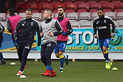AFC Wimbledon midfielder Dean Parrett (18), AFC Wimbledon attacker Egli Kaja (21), AFC Wimbledon defender George Francomb (7) and AFC Wimbledon striker Andy Barcham (17) warming up during the EFL Sky Bet League 1 match between AFC Wimbledon and Northampton Town at the Cherry Red Records Stadium, Kingston, England on 10 February 2018. Picture by Matthew Redman.