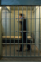 Man walking in prison cell