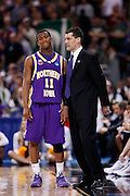 ST. LOUIS, MO - MARCH 26: Kwadzo Ahelegbe #11 of the Northern Iowa Panthers talks with head coach Ben Jacobsen at a break in the game against the Michigan State Spartans during the Midwest regional semi-final of the NCAA men's basketball tournament at the Edward Jones Dome on March 26, 2010 in St. Louis, Missouri. Michigan State advanced with a 59-52 win. (Photo by Joe Robbins)