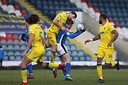 Steven Davies is challenged during the EFL Sky Bet League 1 match between Rochdale and AFC Wimbledon at Spotland, Rochdale, England on 17 March 2018. Picture by Daniel Youngs.