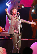 NEW YORK - MARCH 9: The Flaming Lips singer Wayne Coyne performs at the Nickelodeon Upfront 2005 at the Roseland Ballroom March 9, 2004 in New York City.   (Photo by Matthew Peyton)