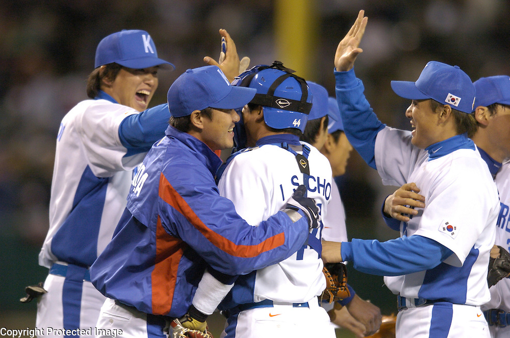 Team Korea celebrates after beating Team Mexico 2-1 in Round 2 action at Angel Stadium of Anaheim.