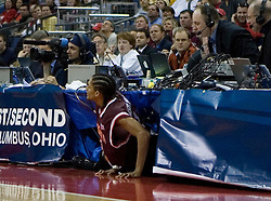 Virginia Tech Hokies forward Deron Washington (13) crashed into the scorer's table in action against SIU.  The #4 seed Southern Illinois Salukis defeated the #5 seed Virginia Tech Hokies 63-48 in the second round of the Men's NCAA Basketball Tournament at the Nationwide Arena in Columbus, OH on March 18, 2007.