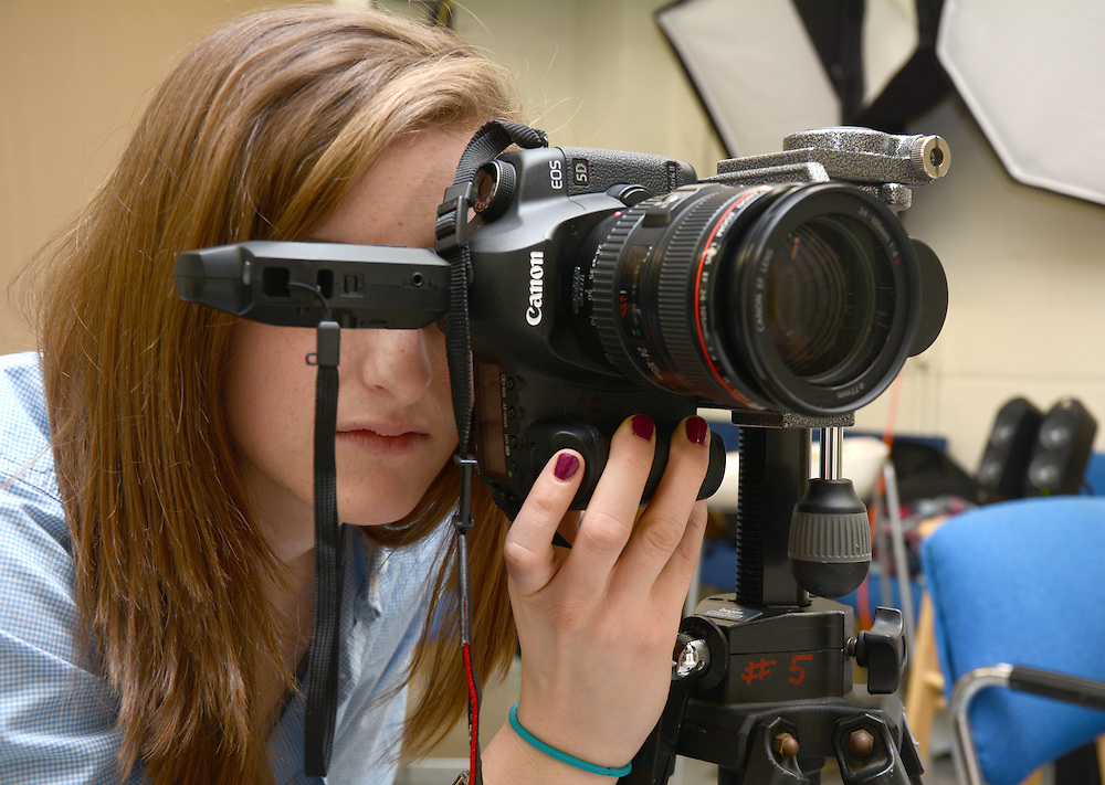 Portrait of VisCom Commercial Photography senior Leah Woodruff working in the studio. Photo by Elizabeth Reyes