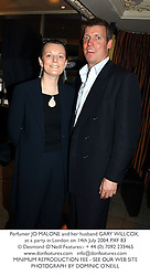 Perfumer JO MALONE and her husband GARY WILLCOX, at a party in London on 14th July 2004.PXF 83