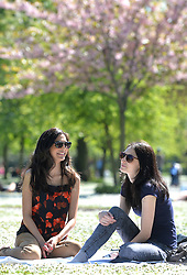(l-r) Teachers Sonam Gadhvi and Michaela Smith make the most of Easter holidays and enjoy the hot spring weather in London's Regent's Park.<br /> Wednesday, 16th April 2014. Picture by Ben Stevens / i-Images