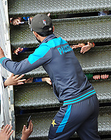 Cricket - 2019 ICC Cricket World Cup - Group Stage: Pakistan vs. Sri Lanka<br /> <br /> Pakistan fans sticks their hands through the steps to shake hands with Hasan Ali after he came out of the dressing room to meet the supporters during the rain delay, at The Bristol County Ground, Bristol.<br /> <br /> COLORSPORT/ANDREW COWIE