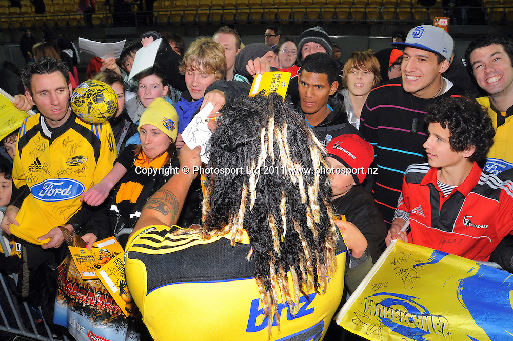 Fans crowd around Ma'a Nonu after his last match for the Hurricanes. Super 15 rugby match - Crusaders v Hurricanes at Westpac Stadium, Wellington, New Zealand on Saturday, 18 June 2011. Photo: Dave Lintott / photosport.co.nz