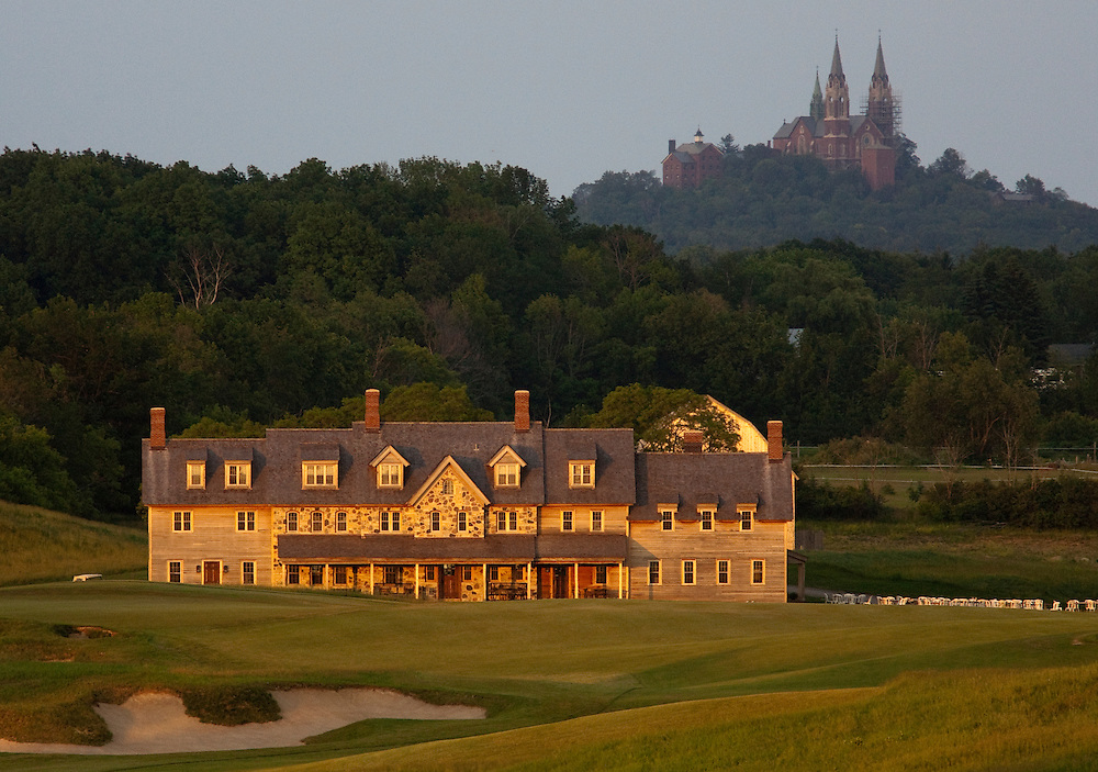 View of the Erin Hills Golf Course clubhouse from the 18th hole with Holy Hill Catholic Monastery looming in the background. Erin Hills is the site of the 2017 US Open of golf. Please send licensing requests to legal@toddbigelowphotography.com