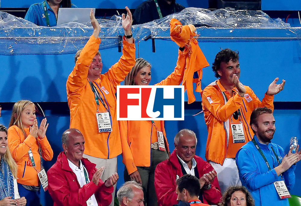 Dutch king Willem-Alexander (L) and his wife Queen Maxima cheer Netherlands' team after winning the women's quarterfinal field hockey Netherlands vs Argentina match of the Rio 2016 Olympics Games at the Olympic Hockey Centre in Rio de Janeiro on August 15, 2016.  / AFP / MANAN VATSYAYANA        (Photo credit should read MANAN VATSYAYANA/AFP/Getty Images)