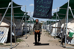 October 5, 2016 - Athens, Greece - A man walks among UNHCR tents set in a sports facility at Helliniko Olympic complex in Athens, Greece on October 5, 2016.Almost 2,500 migrants and refugees, mainly Afghani, are housed at the former Athens airport site, and to an olympic complex used in the 2004 Olympics. In total 60.736 refugees and other migrants are stranded in Greece. (Credit Image: © Panayiotis Tzamaros/NurPhoto via ZUMA Press)