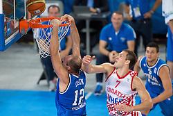 Marco Cusin #12 of Italy vs Bojan Bogdanovic #7 of Croatia during basketball match between national team of Croatia and Italy of Eurobasket 2013 on September 14, 2013 in SRC Stozice, Ljubljana, Slovenia. (Photo By Matic Klansek Velej / Sportida.com)