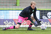 Forest Green Rovers goalkeeper Lewis Thomas(24) warming up during the EFL Sky Bet League 2 match between Forest Green Rovers and Scunthorpe United at the New Lawn, Forest Green, United Kingdom on 7 December 2019.