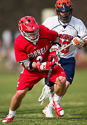 Cornell Big Red A Rob Pannell (3) is defended by Virginia Cavaliers D Matt Kelly (33).  The #1 ranked Virginia Cavaliers defeated the #4 ranked Cornell Big Red 14-10 at Klockner Stadium on the Grounds of the University of Virginia in Charlottesville, VA on March 8, 2009.