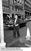 A gentleman hailing a taxi in St James. London 1985.<br /> film 85494 &copy; Copyright Photograph by Dafydd Jones<br /> 66 Stockwell Park Rd. London SW9 0DA<br /> Tel 0171 733 0108