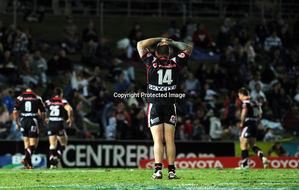 NRL NZ Warriors vs NQ Cowboys from Dairy Farmers Stadium Australia, pics Zak Simmonds.  Warriors Russell Packer after a Cowboys try. 11 August 2012.