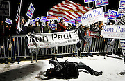 A news photographer takes pictures of a group of Ron Paul supporters out front of St. Anselm College in Manchester, N.H., Jan, 5, 2008.  The college, hosting 'The Presidential Debates', didn't invite Ron Paul.