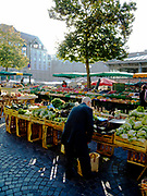 "Rennes, FRANCE.   Saturday Morning Market, ""GV General view of the stalls"",  on display  Brittany. Located.  Marché des Lices Town hall square. Rennes Old quarter, Brittany.<br /> <br /> Saturday  26/09/2009<br /> <br /> © Peter SPURRIER<br /> NIKON - COOLPIX P6000 - 1/125 - f3.2  9.0MB MB"