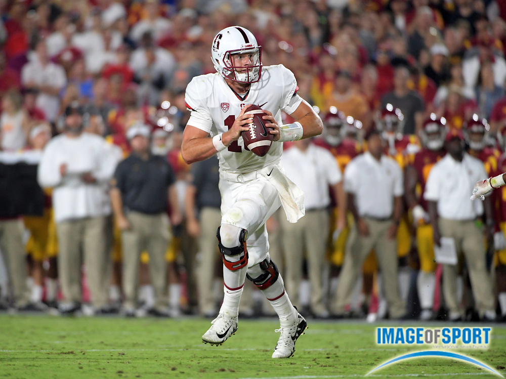 Sep 9, 2017; Los Angeles, CA, USA;Stanford Cardinal quarterback Keller Chryst (10) throws a pass against the Southern California Trojans  during a NCAA football game at Los Angeles Memorial Coliseum. USC defeated Stanford 42-24.