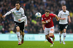 Nottingham Forest Forward Billy Sharp (ENG) breaks from Derby Defender Richard Keogh (IRL) during the first half of the match - Photo mandatory by-line: Rogan Thomson/JMP - Tel: Mobile: 07966 386802 19/01/2013 - SPORT - FOOTBALL - Pride Park - Derby. Derby County v Nottingham Forest - npower Championship. The meeting of these two local sides is known as the East Midlands Derby with the winner claiming the Brian Clough Trophy.