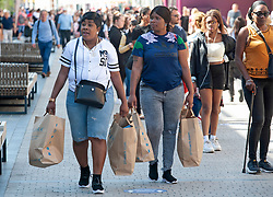 ©Licensed to London News Pictures 15/06/2020<br /> Bromley, UK. Shoppers carrying primark bags in Bromley high street, Bromley, South East London. Shops around the UK have reopened their doors today after three months on Coronavirus lockdown. Photo credit: Grant Falvey/LNP